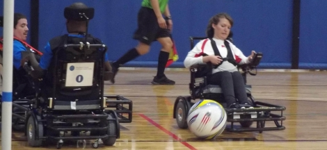 Power soccer player Annie Heathcote scoring a goal