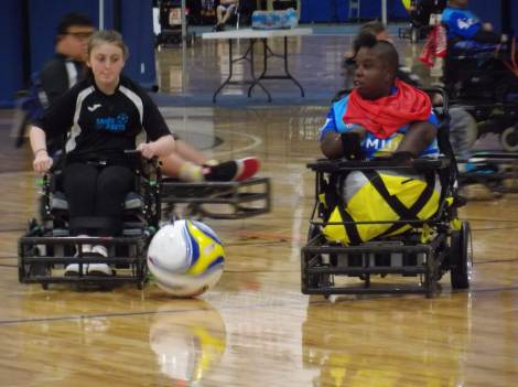 Two power soccer players battling