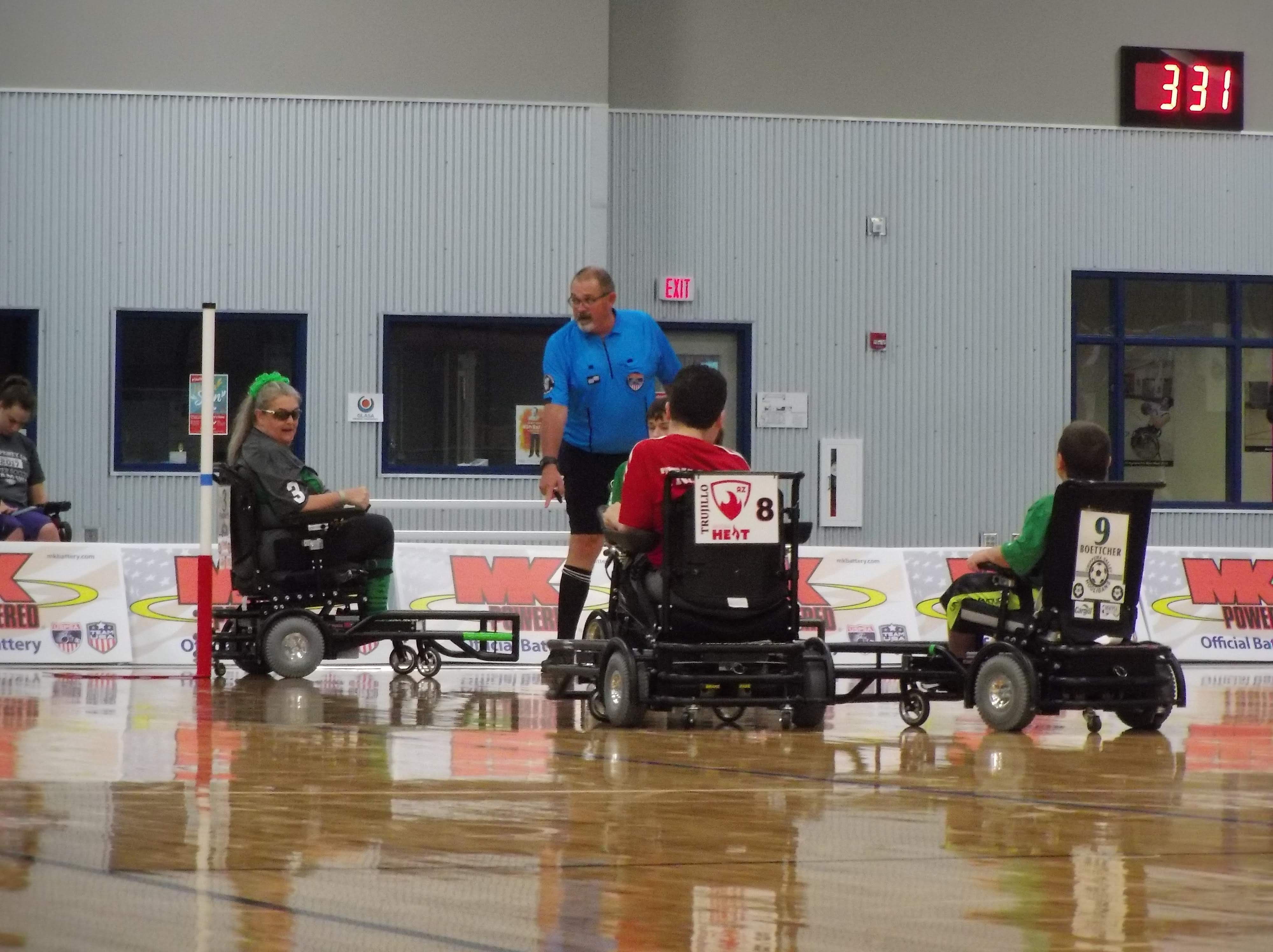 Arizona and Chippewa Valley Power Soccer players on a court