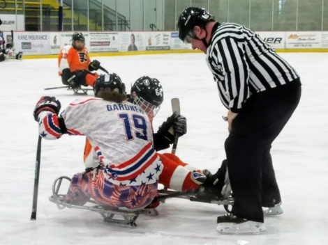 New England Warriors and Philadelphia Flyers Sled Hockey Faceoff