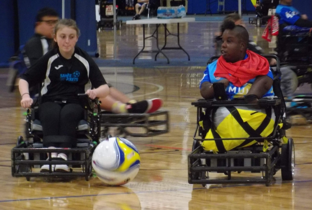 Two battling power soccer players in lower conferences